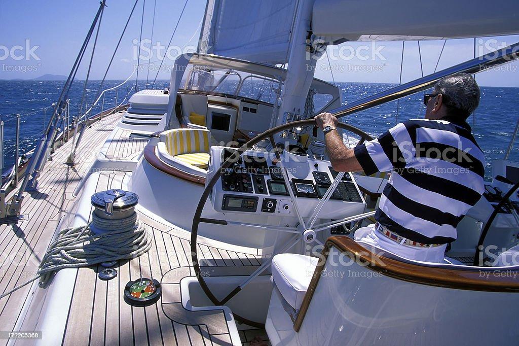 senior man sailing stock photo