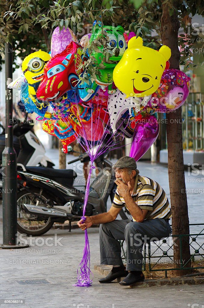 Senior man selling balloons stock photo
