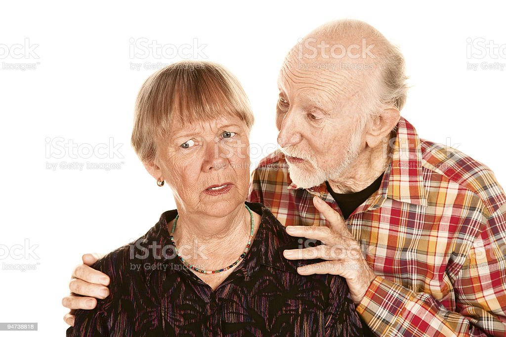 Senior man sharing information with concerned wife royalty-free stock photo
