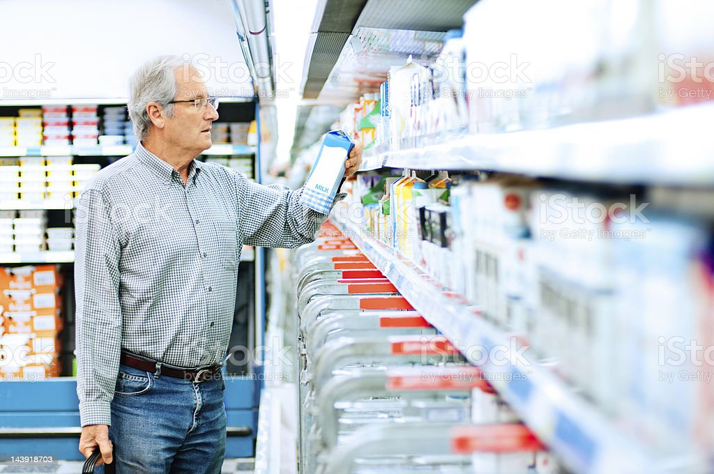 Senior man shopping in supermarket stock photo