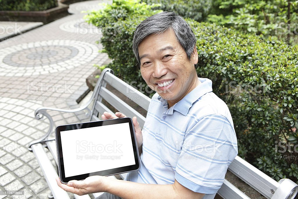 Senior man showing Tablet PC royalty-free stock photo