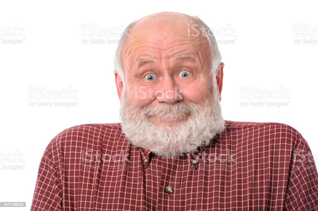 Senior man shows surprised smile facial expression, isolated on white stock photo