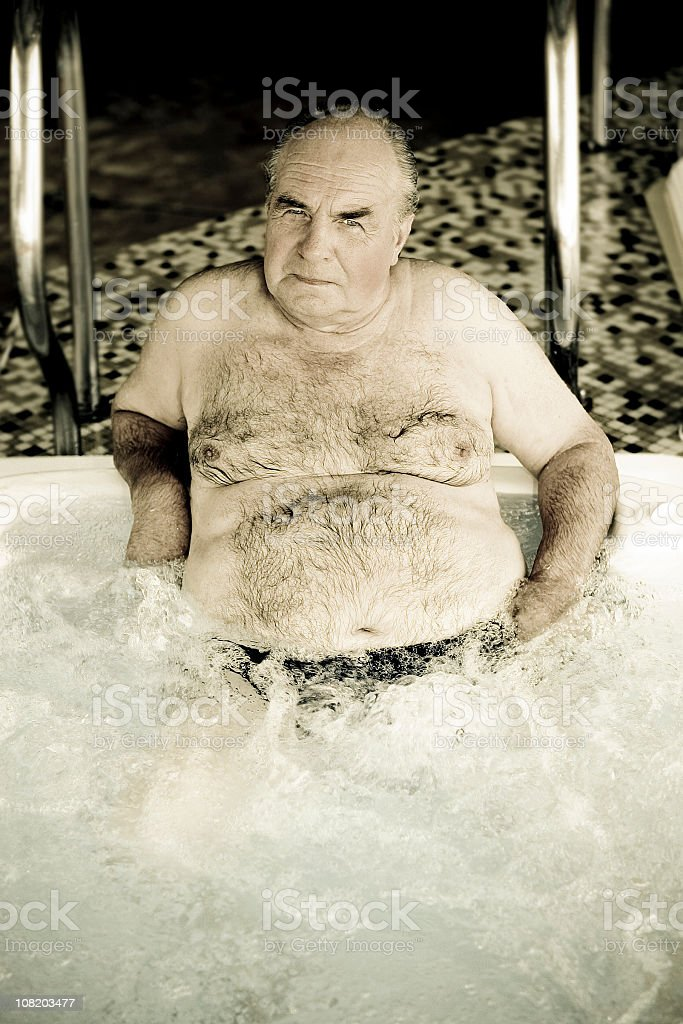 Senior Man Sitting and Relaxing in Hot Tub royalty-free stock photo