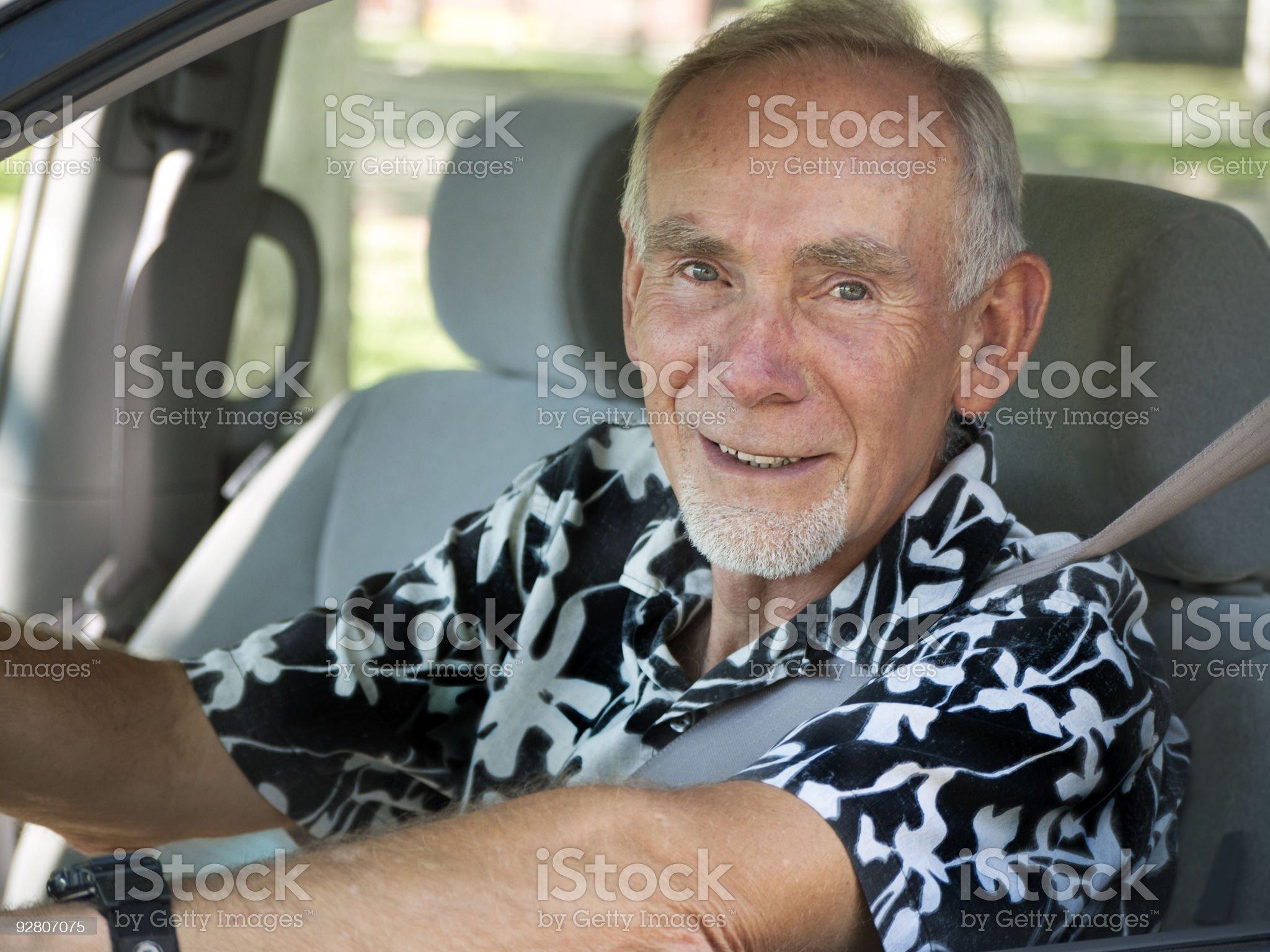 Senior man sitting in front seat of car, smiling. royalty-free stock photo