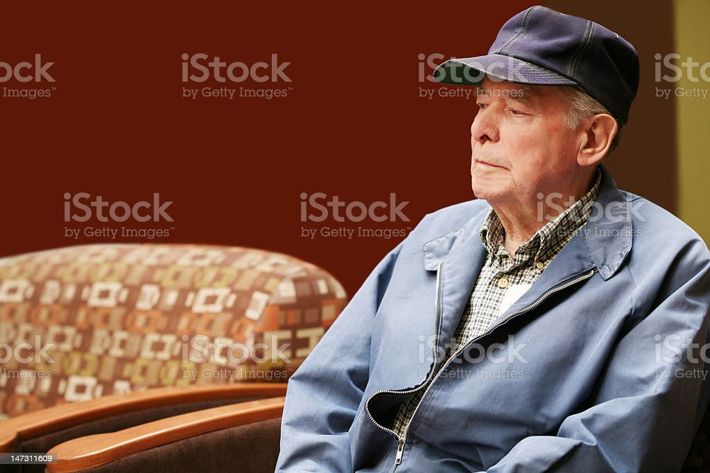 Senior man sitting in waiting room of hospital stock photo