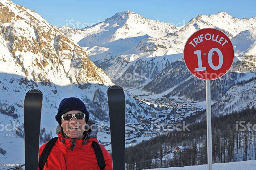 Senior man skier Val d'Isère ski slope sign stock photo