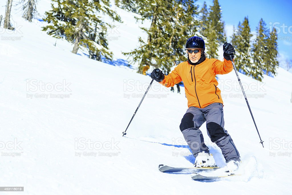 senior man skiing royalty-free stock photo