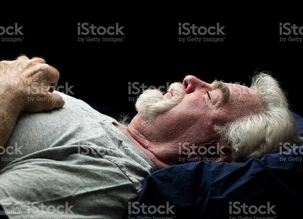 Senior man sleeping stock photo
