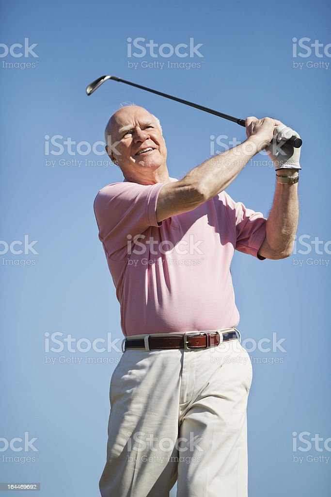 Senior Man Smiling After Taking A Shot royalty-free stock photo