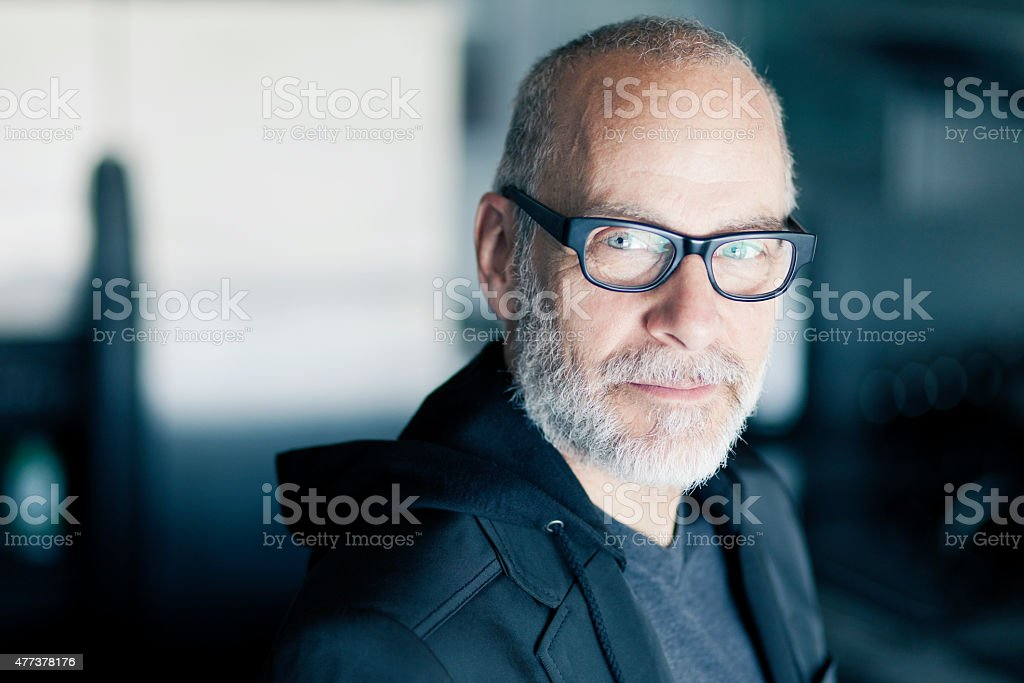Senior Man Smiling At The Camera stock photo