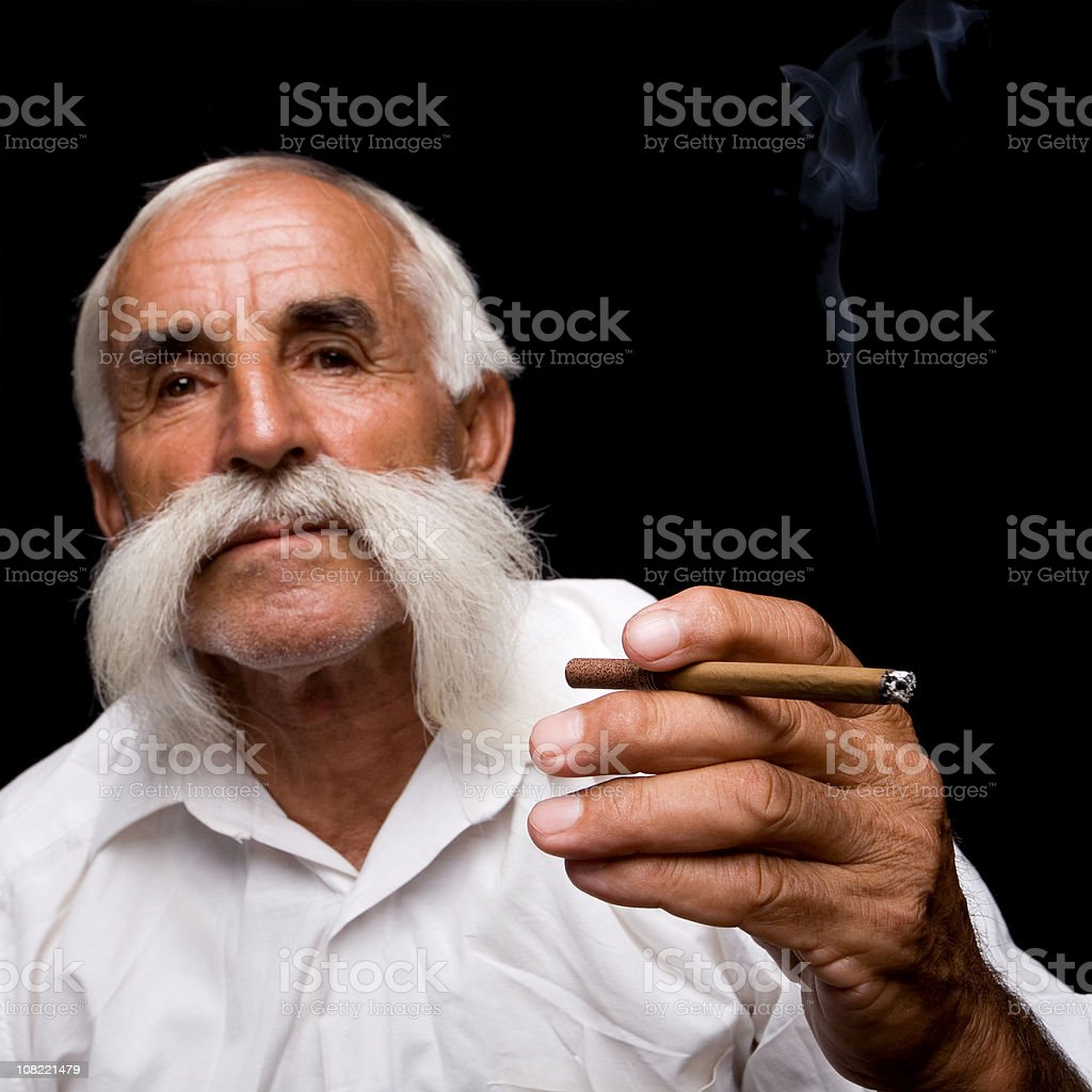 Senior Man Smoking Cigar stock photo