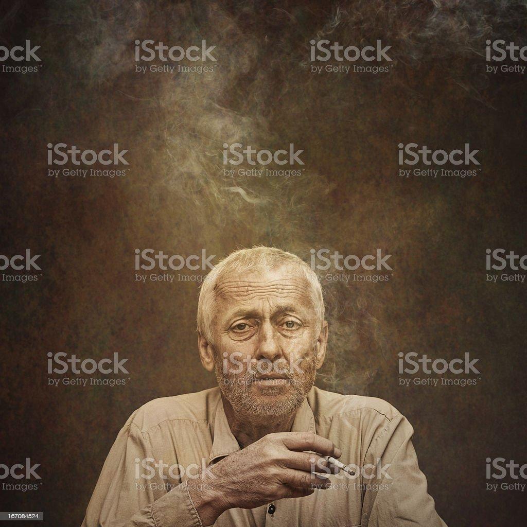 senior man smoking cigarette royalty-free stock photo