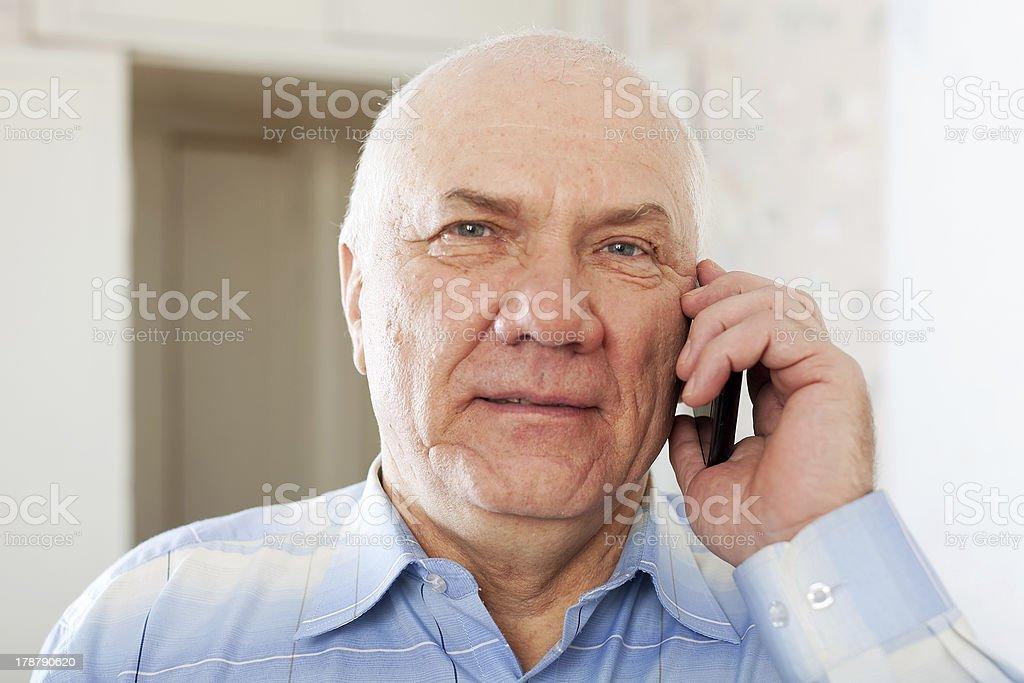 senior man speaking by mobile royalty-free stock photo