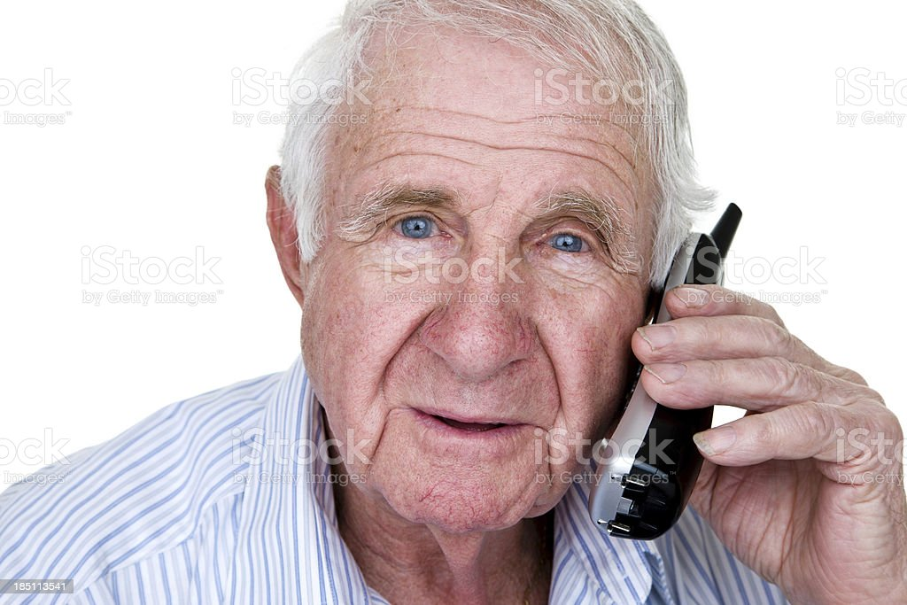Senior man speaking on phone royalty-free stock photo