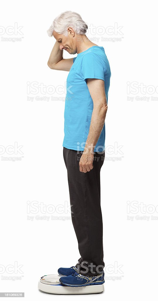 Senior Man Standing On Weight Scale - Isolated royalty-free stock photo