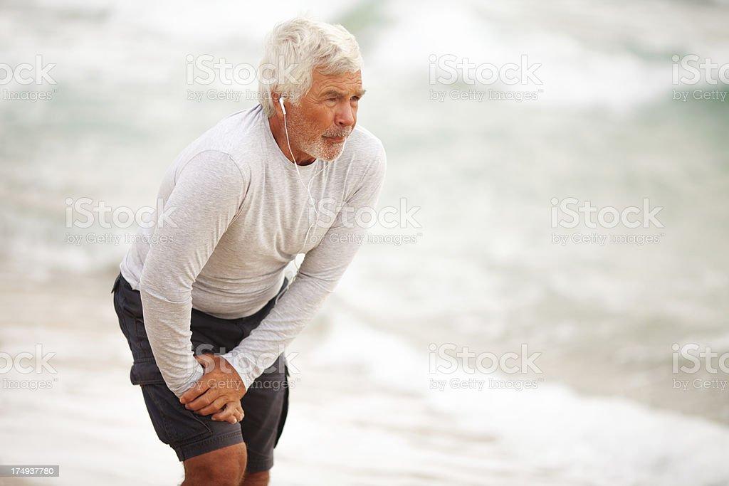 Senior man streching stock photo