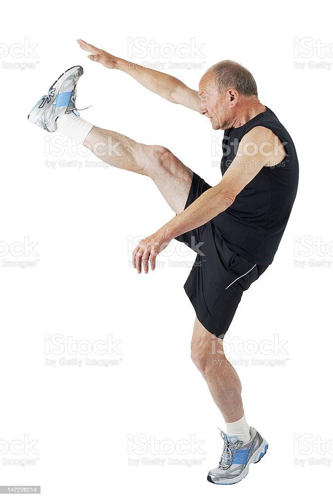 Senior man. Stretching royalty-free stock photo
