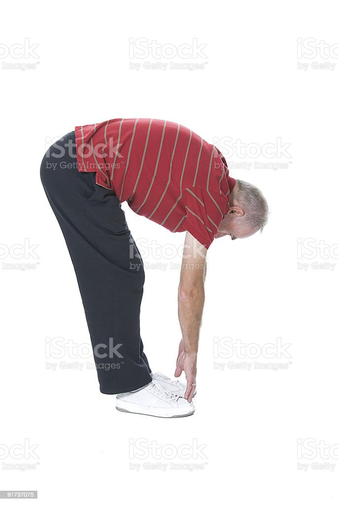 Senior man stretching to touch toes stock photo