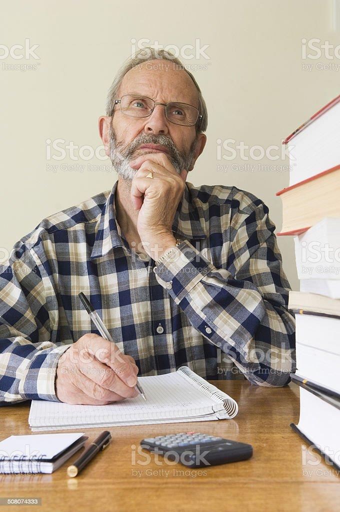 Senior man studying royalty-free stock photo