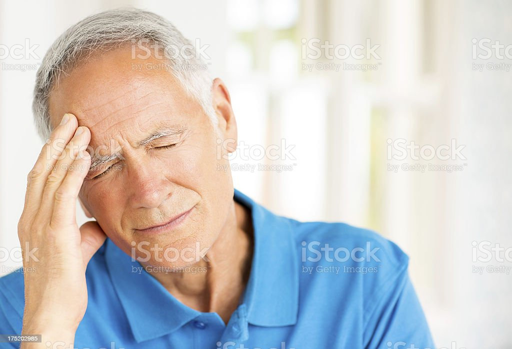 Senior Man Suffering With Headache. stock photo