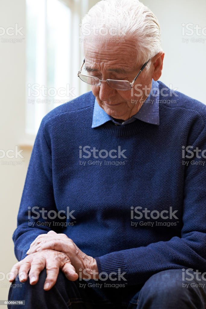 Senior Man Suffering With Parkinsons Diesease stock photo