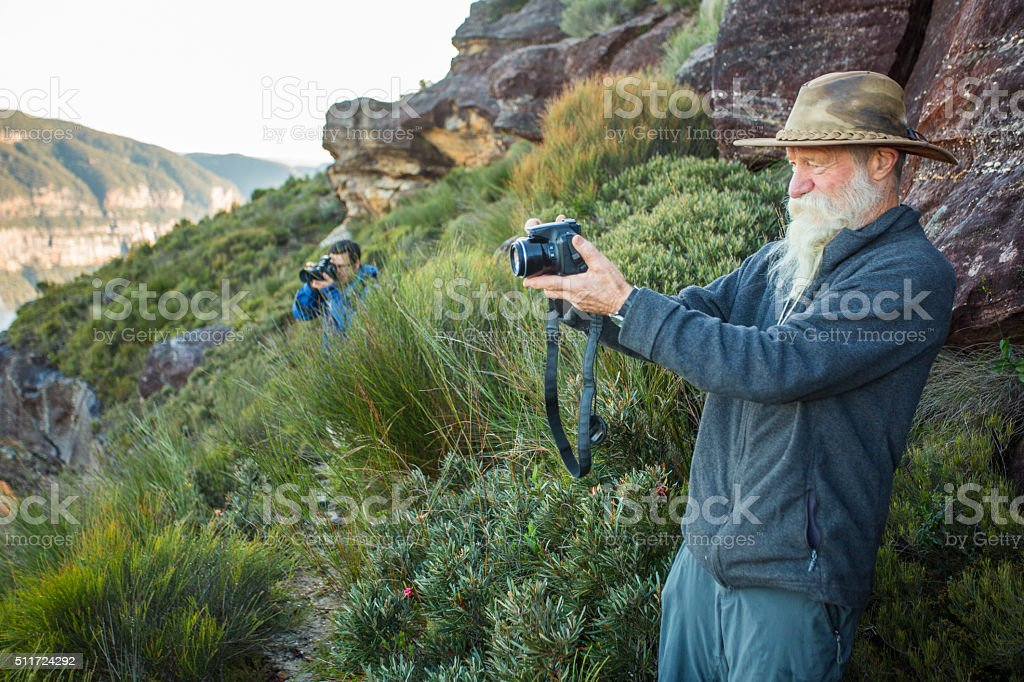 Senior Man Taking Landscape Photographs in Blue Mountains Australia stock photo