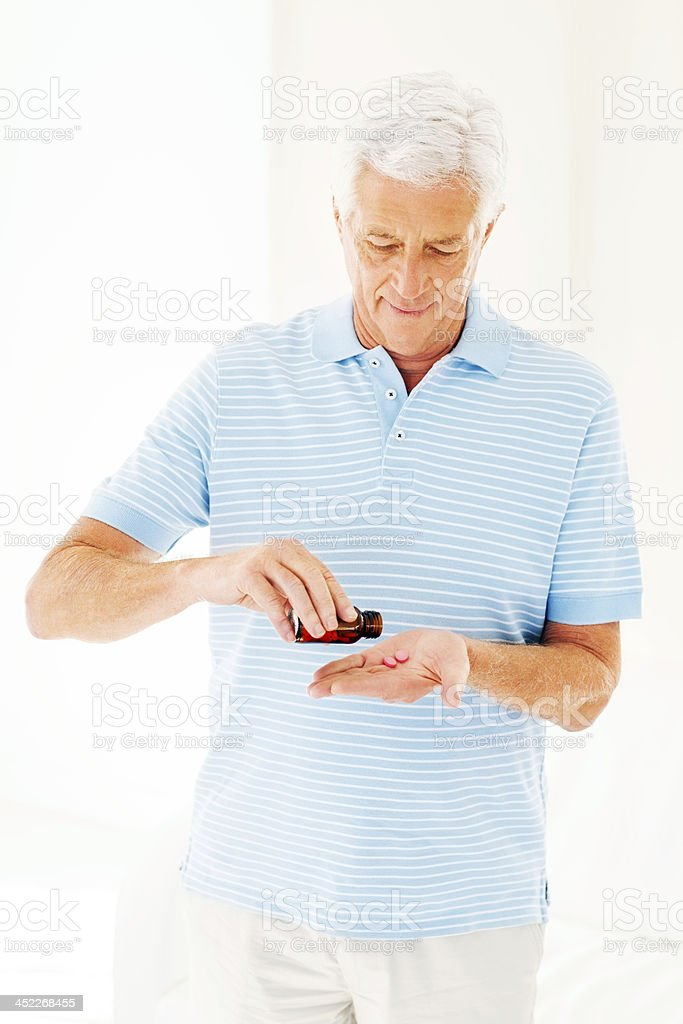 Senior Man Taking Pills From Bottle royalty-free stock photo