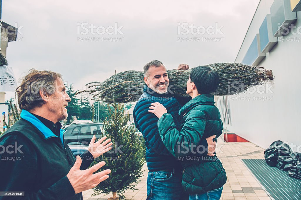 Senior Man Talking, Happy Couple Buying Christmas Tree, Europe stock photo