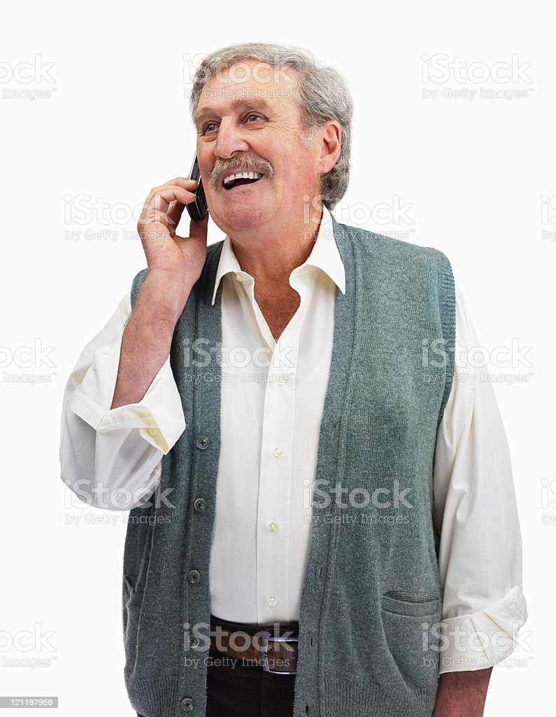 Senior man talking on a cellphone against white royalty-free stock photo