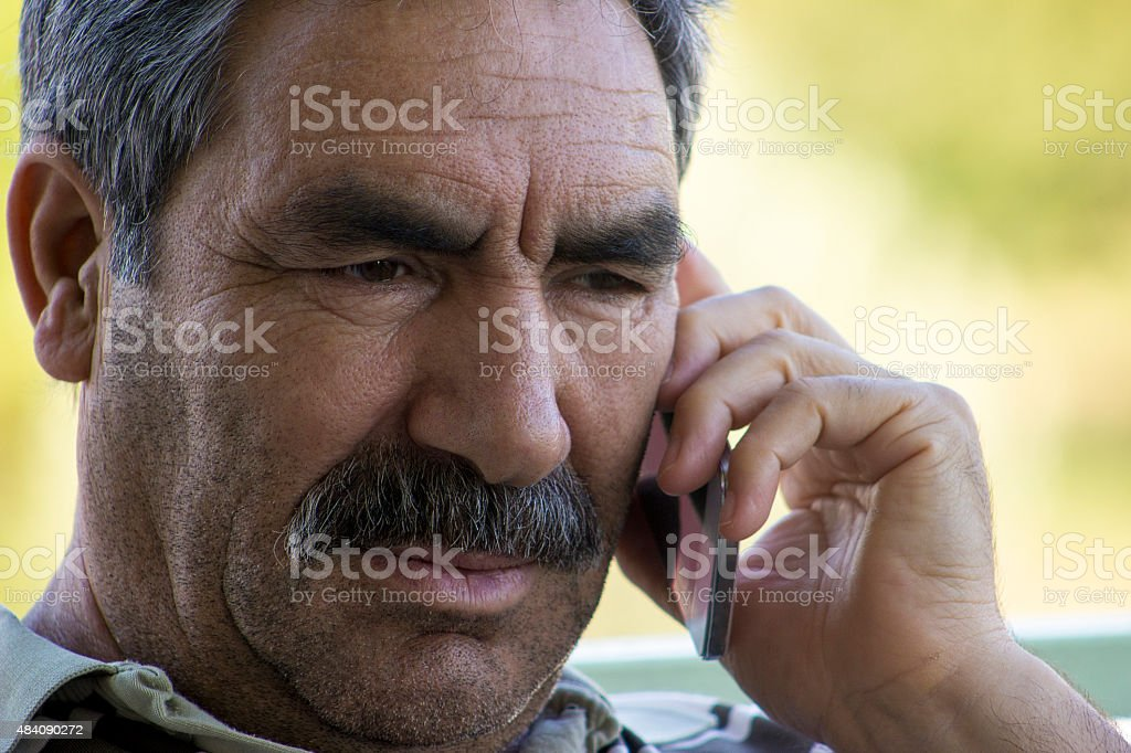 Senior man talking on phone in hopelesness stock photo