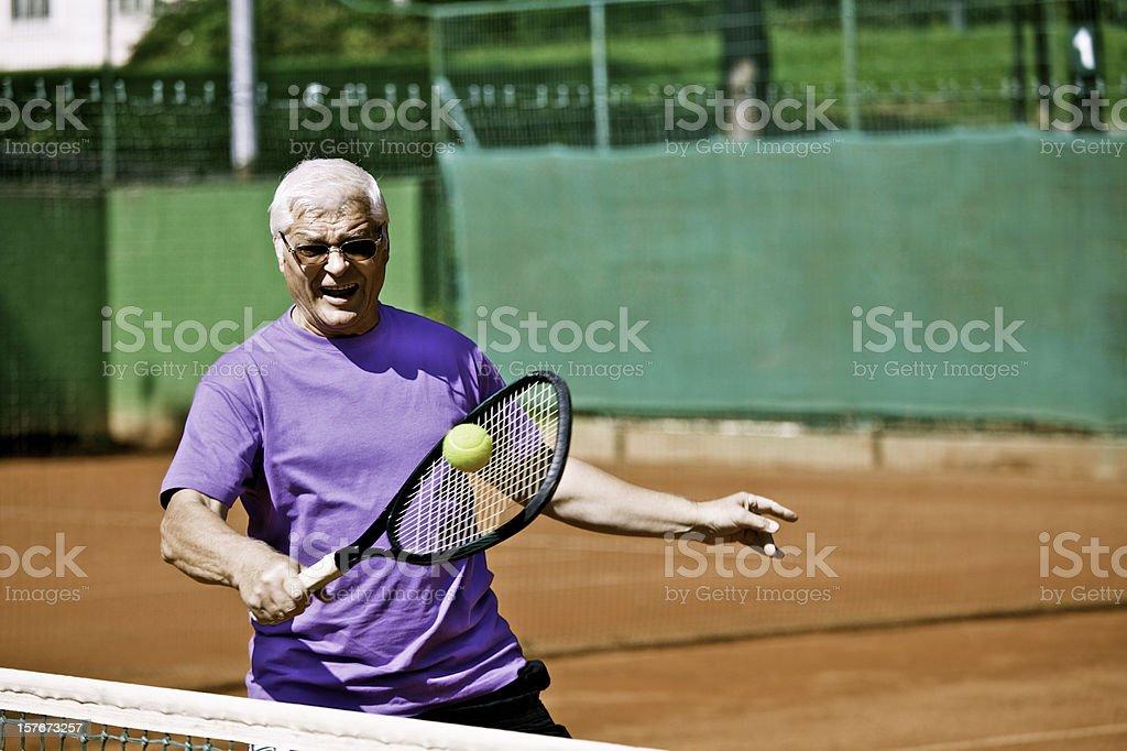 Senior man tennis player on the net royalty-free stock photo