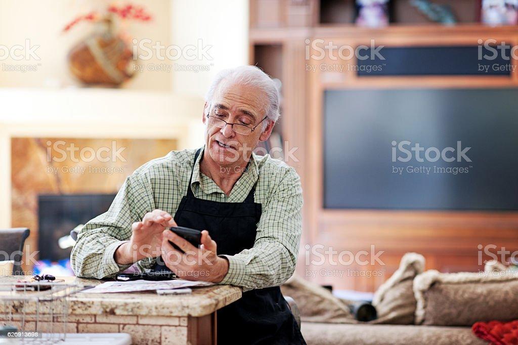 Senior man texting stock photo