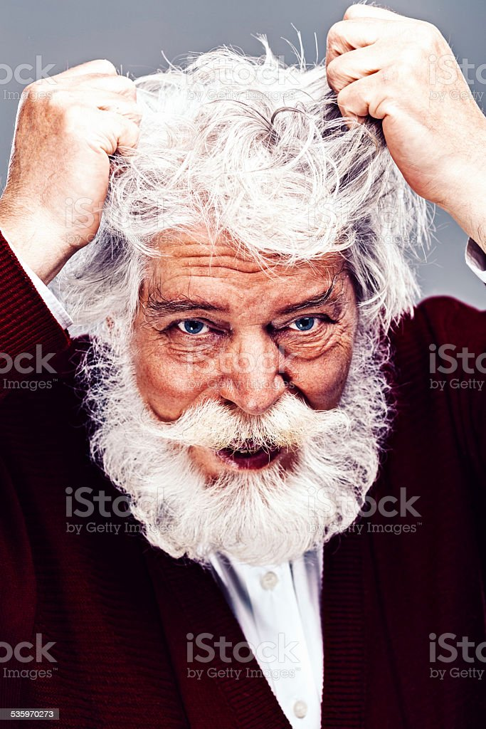 Senior man under pressure stock photo