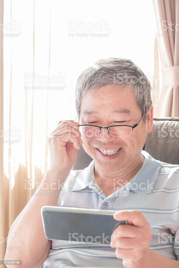 senior man use smart phone stock photo