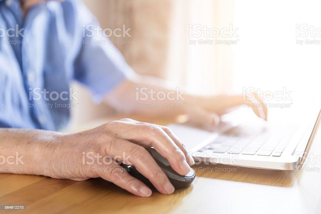 Senior Man Using a Laptop stock photo