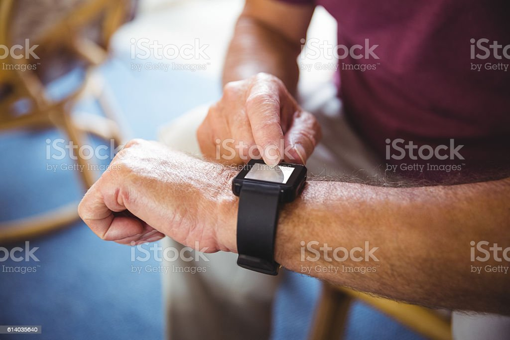 Senior man using a smart watch stock photo
