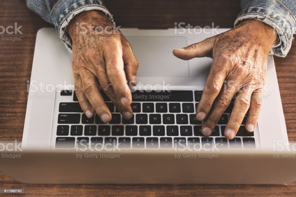 Senior man using computer stock photo