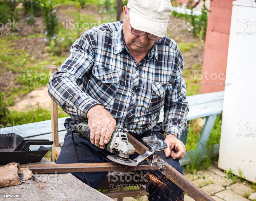 Senior man using grinder stock photo