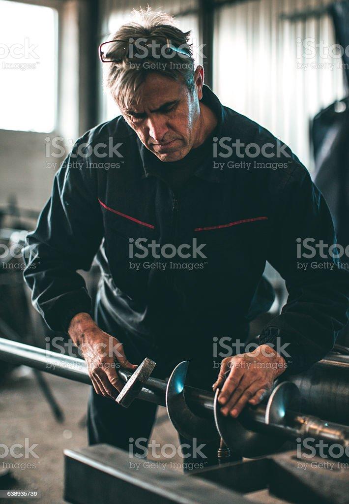 Senior man using hammer... stock photo