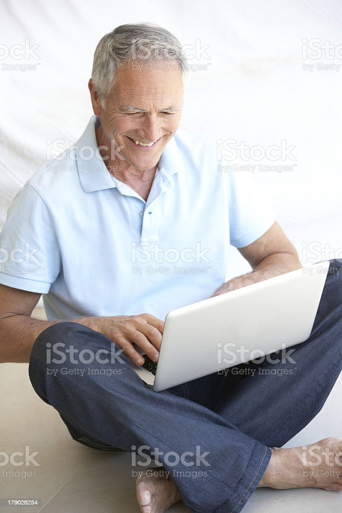 Senior man using laptop computer royalty-free stock photo