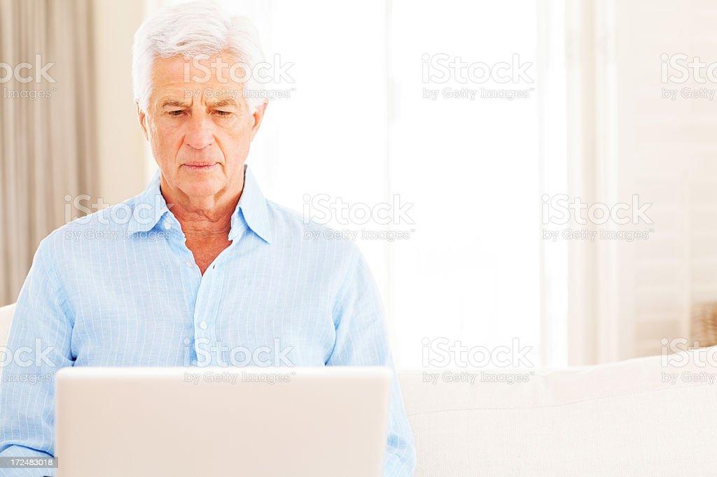 Senior Man Using Laptop royalty-free stock photo
