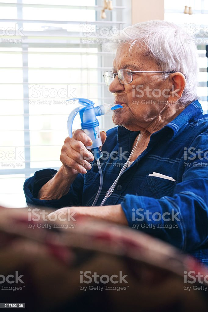 Senior Man Using Nebulizer stock photo