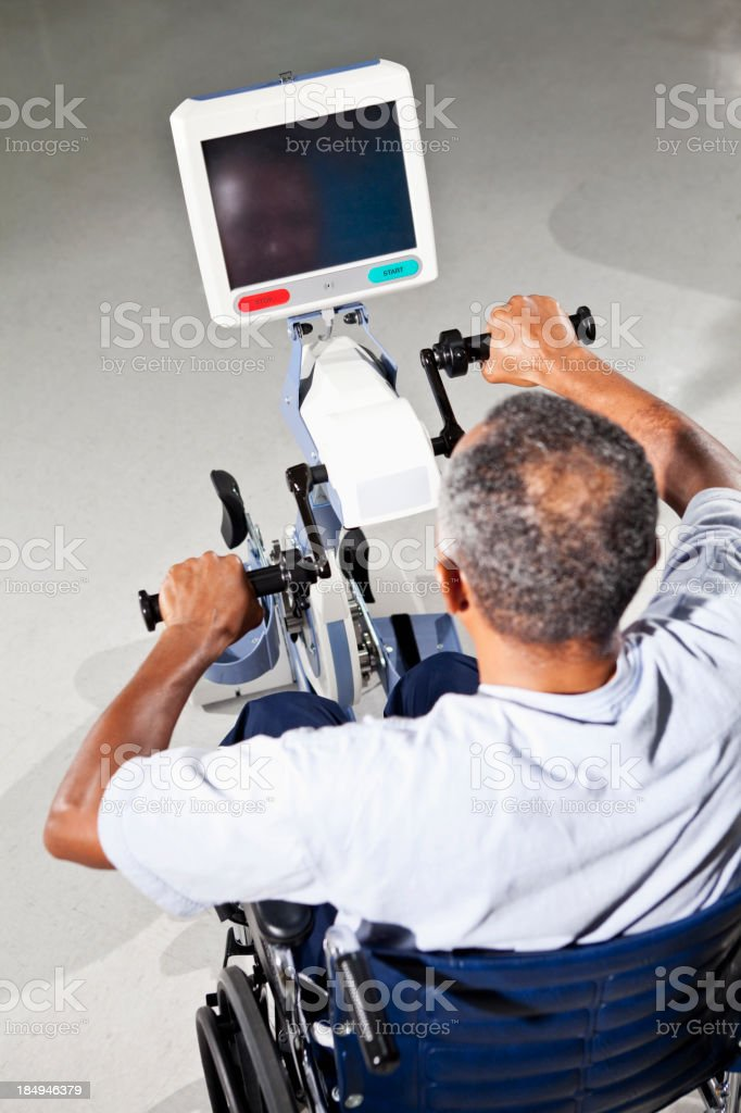Senior man using physical therapy exercise equipment royalty-free stock photo
