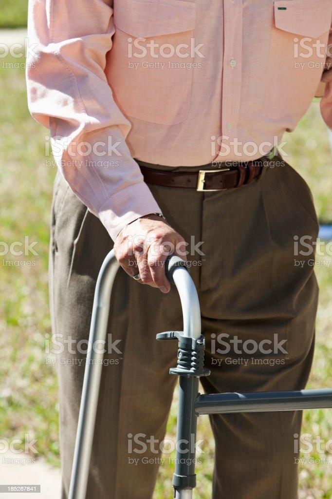 Senior man using walker stock photo
