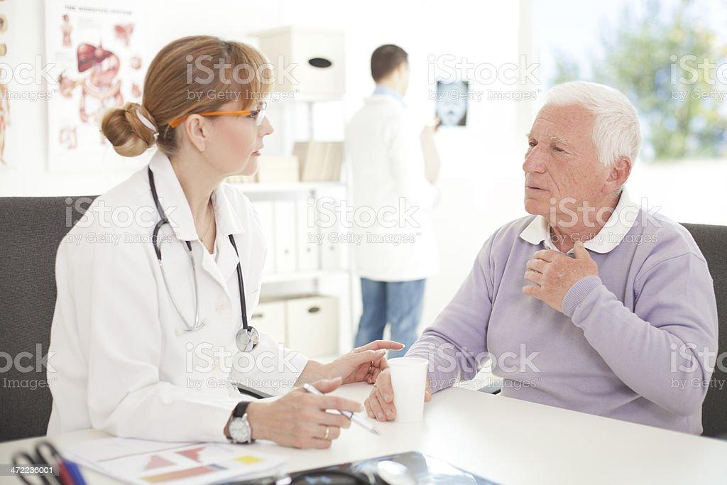 Senior man visiting doctor. royalty-free stock photo