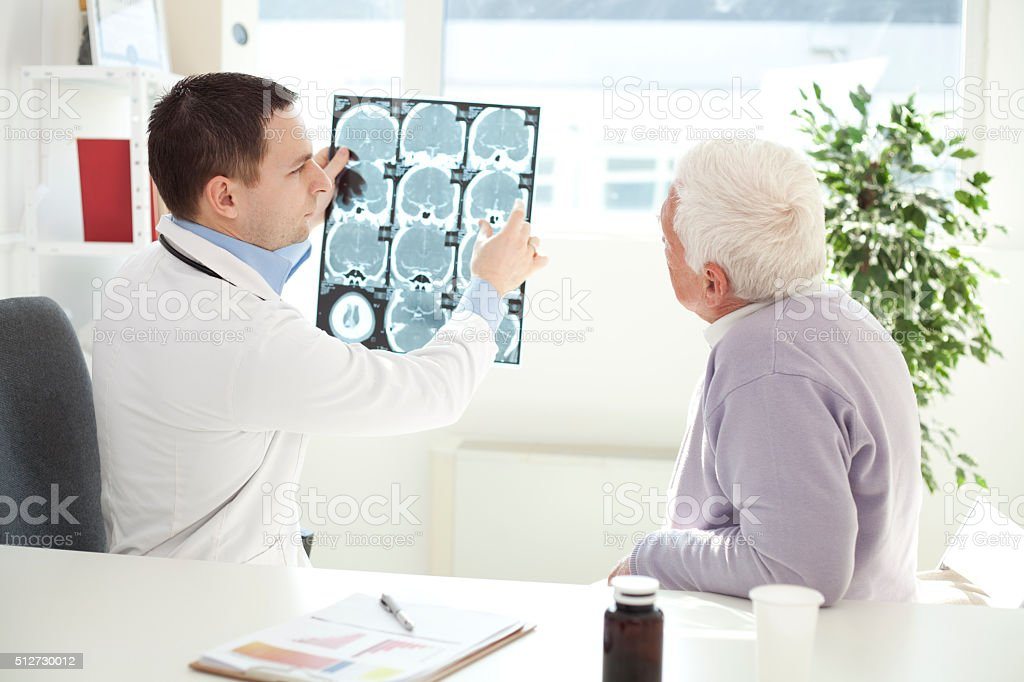 Senior man visiting doctor. stock photo