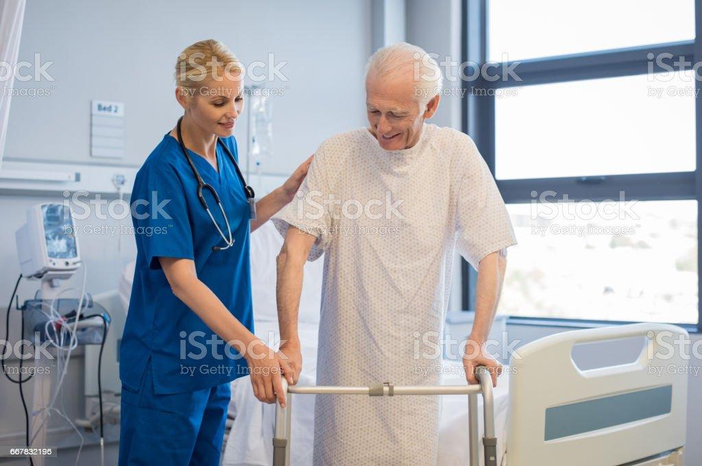 Senior man walking with walker stock photo