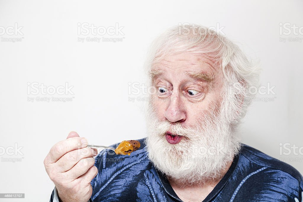 senior man wants to eat chocolate and orange cream dessert stock photo