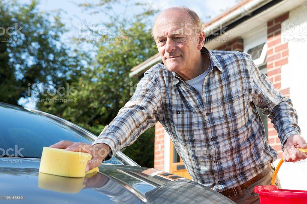 Senior Man Washing Car With Sponge stock photo