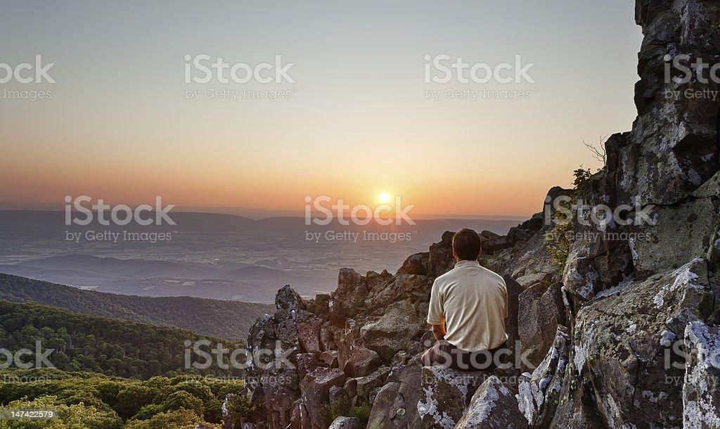 Senior man watches sunrise over blue ridge royalty-free stock photo